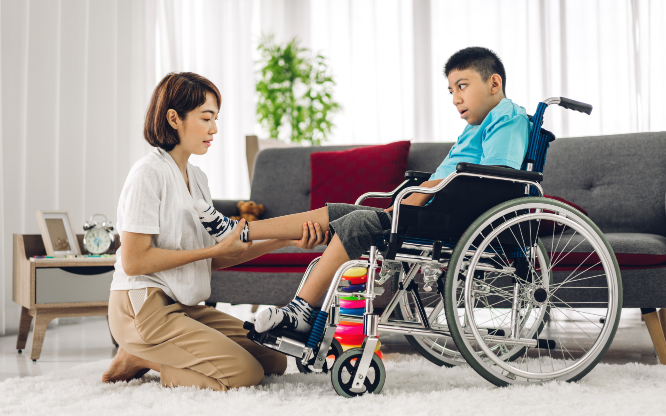 portrait-asian-physiotherapist-carer-helping-playing-with-special-disabled-child-health-problem-by-doing-exercises-sitting-wheelchair-rehabilitation-clinic-disability-care-concept 1